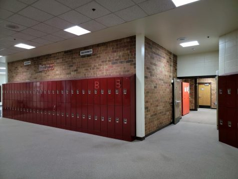 Freshman hallway, north of the middle stairs.